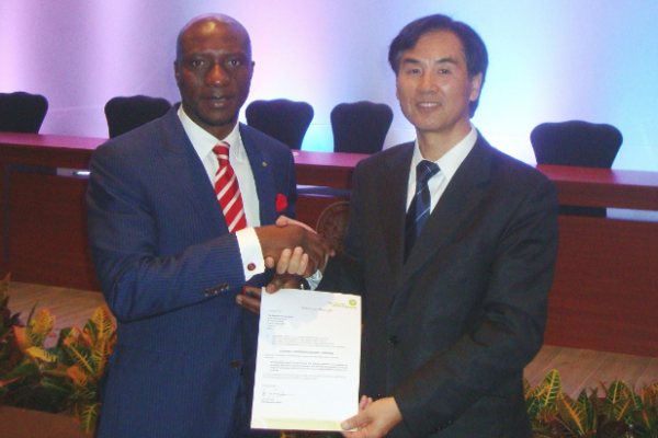 Nigerian Stock Exchange CEO Mr. Oscar Onyema, with the Director of UNCTAD's Division on Investment and Enterprise, Mr. James Zhan, at the annual meeting of the World Federation of Exchanges, in Mexico.
